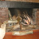                    A warm and welcomming fireplace next to our table.