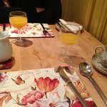 Fresh orange juice & coffee in lovely breakfast room!