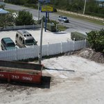 view from deck of dumpster, pkg lot, seaweed pile, hwy
