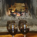sipping wine in front of the fire