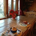                   Dining room has view overlooking the river.  Warm wood interior