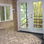 French doors open to a bamboo garden