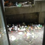 Rubbish and filth from side entrance into lobby