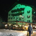                                      The green light on the hotel at night.