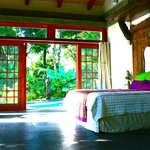 Guest Villa Bedroom, with view onto private pool