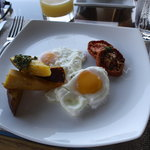                                      Breakfast at the restaurant - eggs with potatoes and smoked 