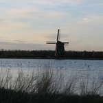                    Windmill across a nearby lake
