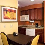 Fully equipped and ready for home-style cooking, the kitchen in this two-bedroom suite has what
