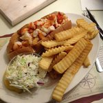Lobster roll, french fries, and coleslaw