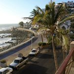                    View from our balcony of the malecon, street and beach.