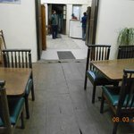 Dining area with broken flooring