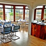 Dining Room and decking overlooking river