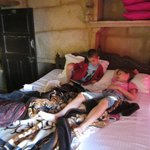 Children relaxing in the bedroom.