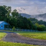  Small barn with mountains in the background