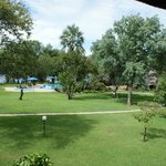 View from room of pool area leading to Zambezi River
