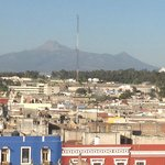 La Malinche Volcano seen from east facing room on sixth floor.