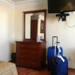 NIce flat screen TV. Besides this mirror and bureau, there is a roomy closet and dressing mirror