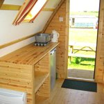fridge, kettle, heating & lighting inside camping cabins