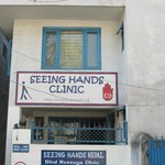 Seeing hands is just past  the Gaia Restaurant.