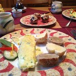 omelet with fresh baked gluten free bread and muffins