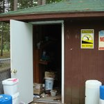 pool shed open, chemicals out and open, electrical cords, et