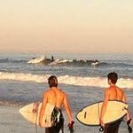  Surfers in the setting sun at Wrightsville Beach