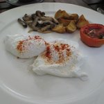 English breakfast with perfectly poached eggs