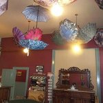  Umbrellas hang from the coffee shop ceiling.