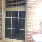  Floor to ceiling window to view a brick wall