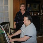 Michael the Innkeeper playing piano for the guests and singalong!