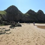 THREE CLIFFS BAY - CAN YOU SPOT THE GAP IN THE ROCKS - THE BAY THROUGH THE OTH
