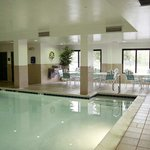  Guests enjoy exercising or relaxing in a beautiful indoor pool area.