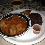  Oxtail stew served with rice and black beans, Cuban style.  Yum!