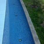  Side of pool, water steady flows.
