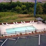 Relax by the seasonal outdoor pool