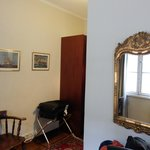 Good sizes room with large wardrobe and good size mirror