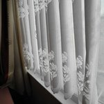  See how clean the lace curtains are.