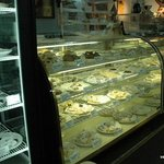 Pastry case filled with tempting edible treasures