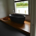  Stunning stone bath overlooking the lake