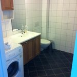  Spacious bathroom with washing machine and floor heating