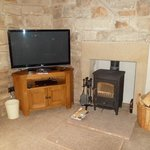 TV next to log burner