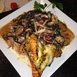 black ink linguini al ajillo, chile guajillo sautéed with garlic white wine with black ink squid