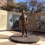 A Memorial Plaza to JFK stands in front of the FW Hilton
