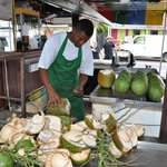 Getting the coconuts ready to drink