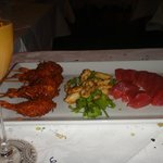 Mimosa + Appetizers: coconut prawns, squid, and sashimi