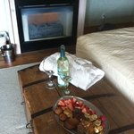 wine, strawberries, chocolates, candies, and bathrobes in our room after horseback ride