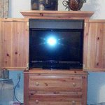 beautiful armoire with tv