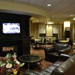 The lobby / common area with nice seating & TV.