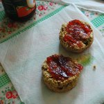 warm scones with melted butter and strawberry jam