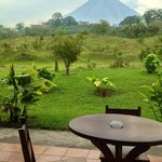 Enchanting view of Arenal from bedroom window.